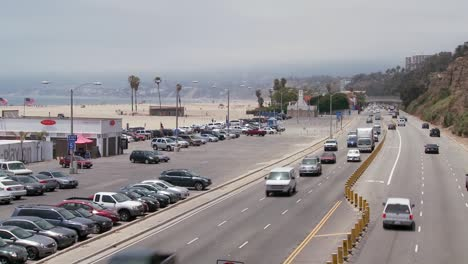 Follow-shot-up-from-car-driving-on-Highway-101-to-reveal-the-Santa-Monica-beach