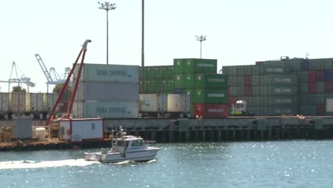 A-harbor-boat-passes-beside-Long-Beach-harbor-and-shipping-containers
