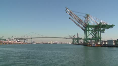 POV-shot-from-a-boat-of-cranes-and-Long-Beach-San-pedro-harbor-scenes