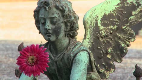 An-angel-sculpture-in-a-cemetery-on-a-grave