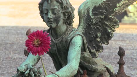 An-angel-sculpture-in-a-cemetery-on-a-grave-1
