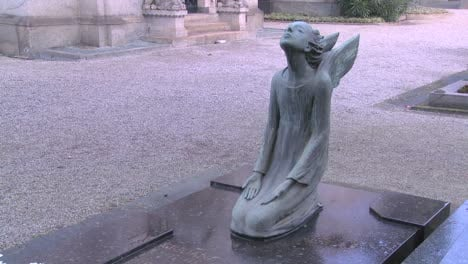 An-angel-sculpture-in-a-cemetery-on-a-grave-4