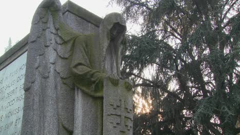 A-ghostly-angel-looks-down-on-a-grave-from-above
