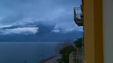 Time-lapse-of-fog-rolling-over-mountains-with-a-hotel-balcony-in-the-foreground