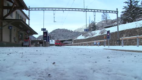 A-Swiss-rail-train-arrives-at-a-station-in-Switzerland-in-winter