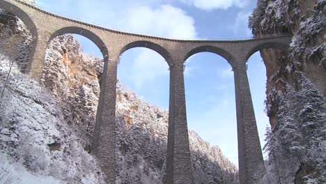 A-train-in-Europe-crosses-a-remarkable-bridge-and-plunges-directly-into-a-tunnel-1