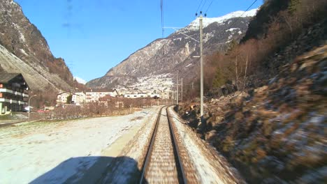 A-POV-shot-from-the-front-of-a-train-moving-through-a-mountainous-region