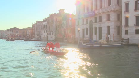 A-gondola-is-rowed-along-the-Grand-Canal-in-Venice-Italy