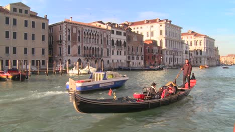 A-gondola-is-rowed-along-the-Grand-Canal-in-Venice-Italy-1