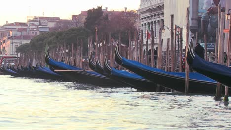 Gondolas-bob-in-the-waves-along-a-canal-in-Venice-Italy