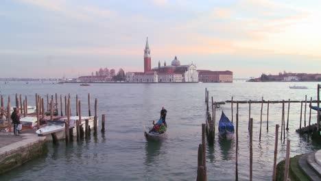A-gondola-is-rowed-in-front-of-Isola-di-San-Giorgio-Maggiore-in-Venice-Italy