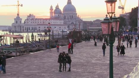Pedestrians-walk-along-the-canals-near-St-Marks-in-Venice-Italy