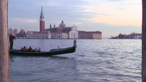 A-gondola-is-rowed-in-front-of-Isola-di-San-Giorgio-Maggiore-in-Venice-Italy-1