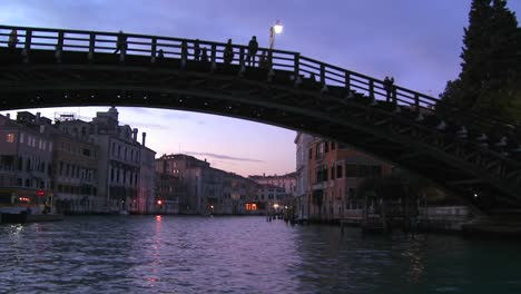 Dusk-on-the-canals-of-Venice-Italy-passing-under-the-Academia-Bridge