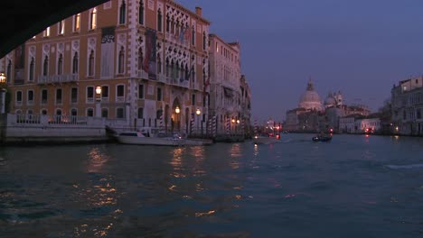Dusk-on-the-canals-of-Venice-Italy-passing-under-the-Academia-Bridge-1