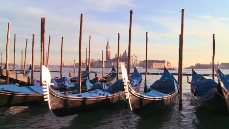 Rows-of-gondolas-line-a-canal-in-Venice-Italy-1