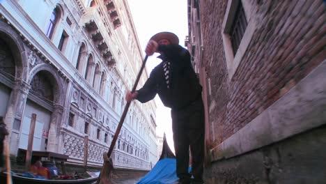 A-nice-shot-of-a-gondolier-rowing-a-gondola-under-a-bridge-in-Venice-Italy-2