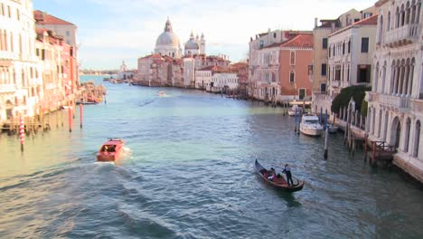 A-gondolier-rows-and-we-reveal-a-beautiful-canal-in-Venice-Italy