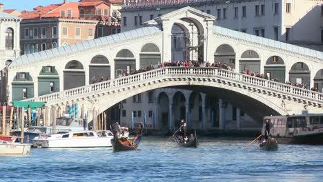 Gondolas-under-the-Rialto-Bridge-in-Venice-Italy