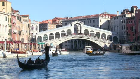 Gondolas-under-the-Rialto-Bridge-in-Venice-Italy-1