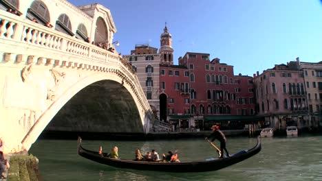 Gondolas-under-the-Rialto-Bridge-in-Venice-Italy-3