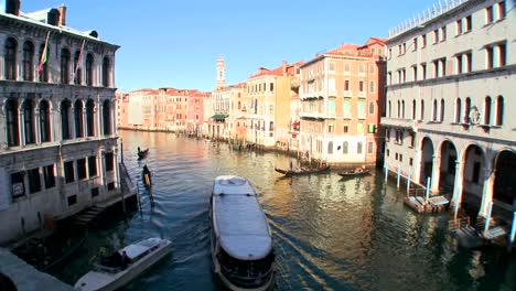 Boats-move-along-the-Grand-Canal-in-Venice-Italy