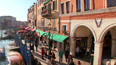 Cool-timelapse-shot-of-pedestrians-walking-along-the-canals-of-Venice-Italy