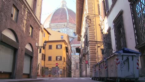 A-beautiful-cathedral-dome-looms-over-the-city-streets-of-Florence-Italy