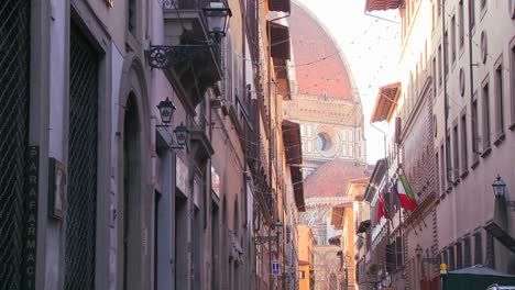 A-beautiful-cathedral-dome-looms-over-the-city-streets-of-Florence-Italy-1