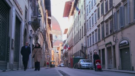 A-beautiful-cathedral-dome-looms-over-the-city-streets-of-Florence-Italy-2