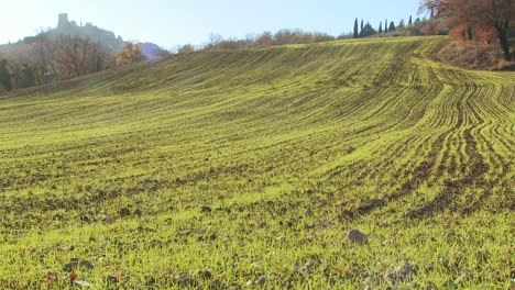 A-wide-shot-of-the-green-Italian-countryside-with-a-distant-castle-adding-mystery
