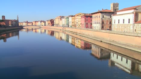 Buildings-line-a-symmetrical-canal-in-Pisa-Italy