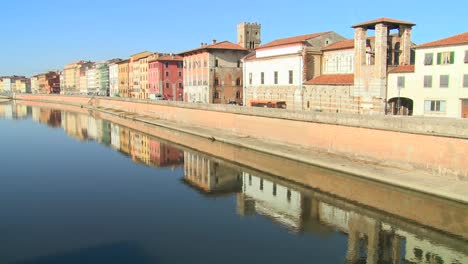 Buildings-line-a-symmetrical-canal-in-Pisa-Italy-1