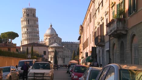A-street-in-Pisa-Italy-with-the-leaning-tower-in-background