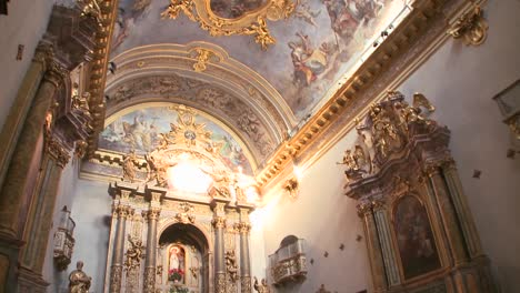 The-interior-of-a-small-ornate-Catholic-church-with-beautiful-paintings-on-ceiling