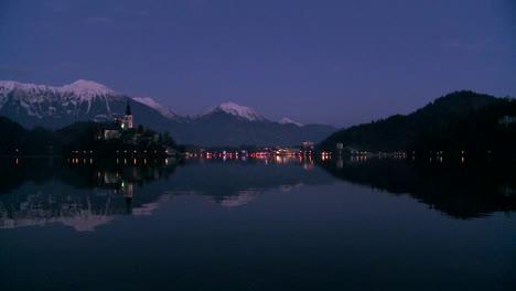 A-small-church-on-an-island-at-dawn-at-Lake-Bled-Slovenia-5