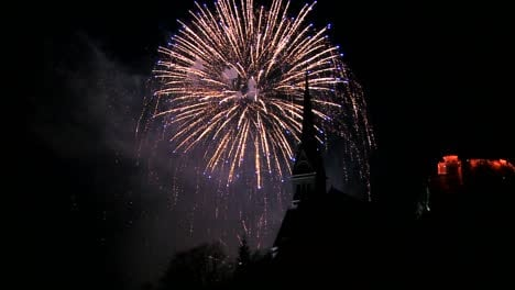 A-magnificent-fireworks-display-behind-a-church