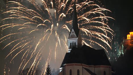 A-magnificent-fireworks-display-behind-a-church-1