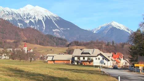 Cars-drive-through-the-countryside-of-Slovenia-or-an-Eastern-European-nation-1
