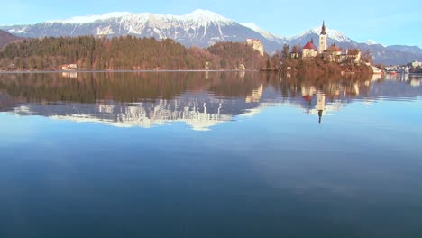 A-beautiful-church-stands-on-an-island-on-Lake-Bled-Slovenia-1