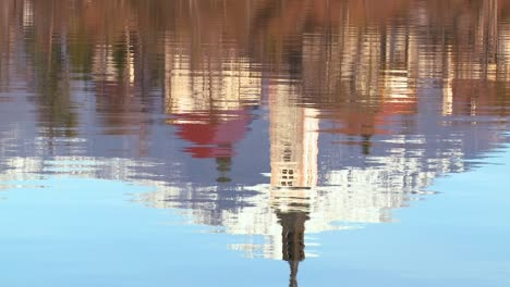 The-reflection-of-a-church-steeple-in-the-waters-of-Lake-Bled-Slovenia