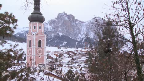 Church-steeple-in-a-snowbound-Tyrolean-village-in-the-Alps-in-Austria-Switzerland-Italy-Slovenia-or-an-Eastern-European-country