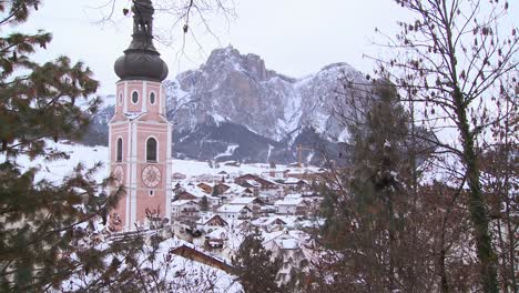 Church-steeple-in-a-snowbound-Tyrolean-village-in-the-Alps-in-Austria-Switzerland-Italy-Slovenia-or-an-Eastern-European-country-1