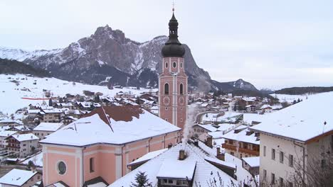 A-church-in-a-snowbound-Tyrolean-village-in-the-Alps-in-Austria-Switzerland-Italy-Slovenia-or-an-Eastern-European-country
