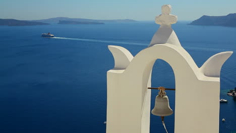 A-cruise-ship-in-the-distance-behind-a-Greek-Island-church