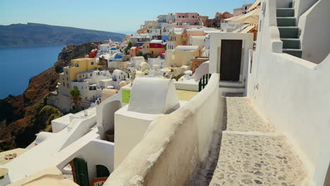 Pan-across-the-village-of-Oia-on-the-Greek-Island-of-Santorini-reveals-church