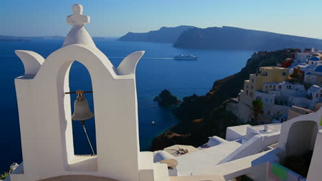 A-cruise-ship-passes-a-Greek-Orthodox-church-on-the-Greek-island-of-Santorini