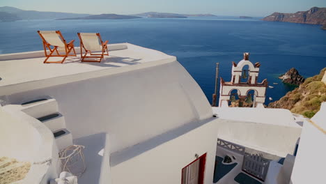 Deck-chairs-sit-on-a-beautiful-balcony-in-the-Greek-Islands-2