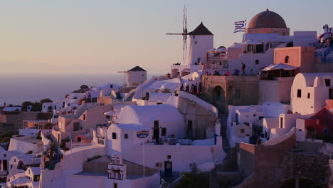White-buildings-and-windmills-line-the-hillsides-of-the-Greek-Island-of-Santorini-at-dusk-1