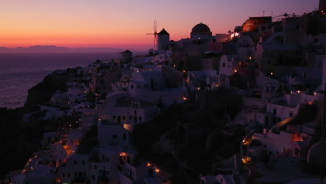 Windmills-at-dusk-or-sunset-on-the-romantic-Greek-Island-of-Santorini-at-dusk